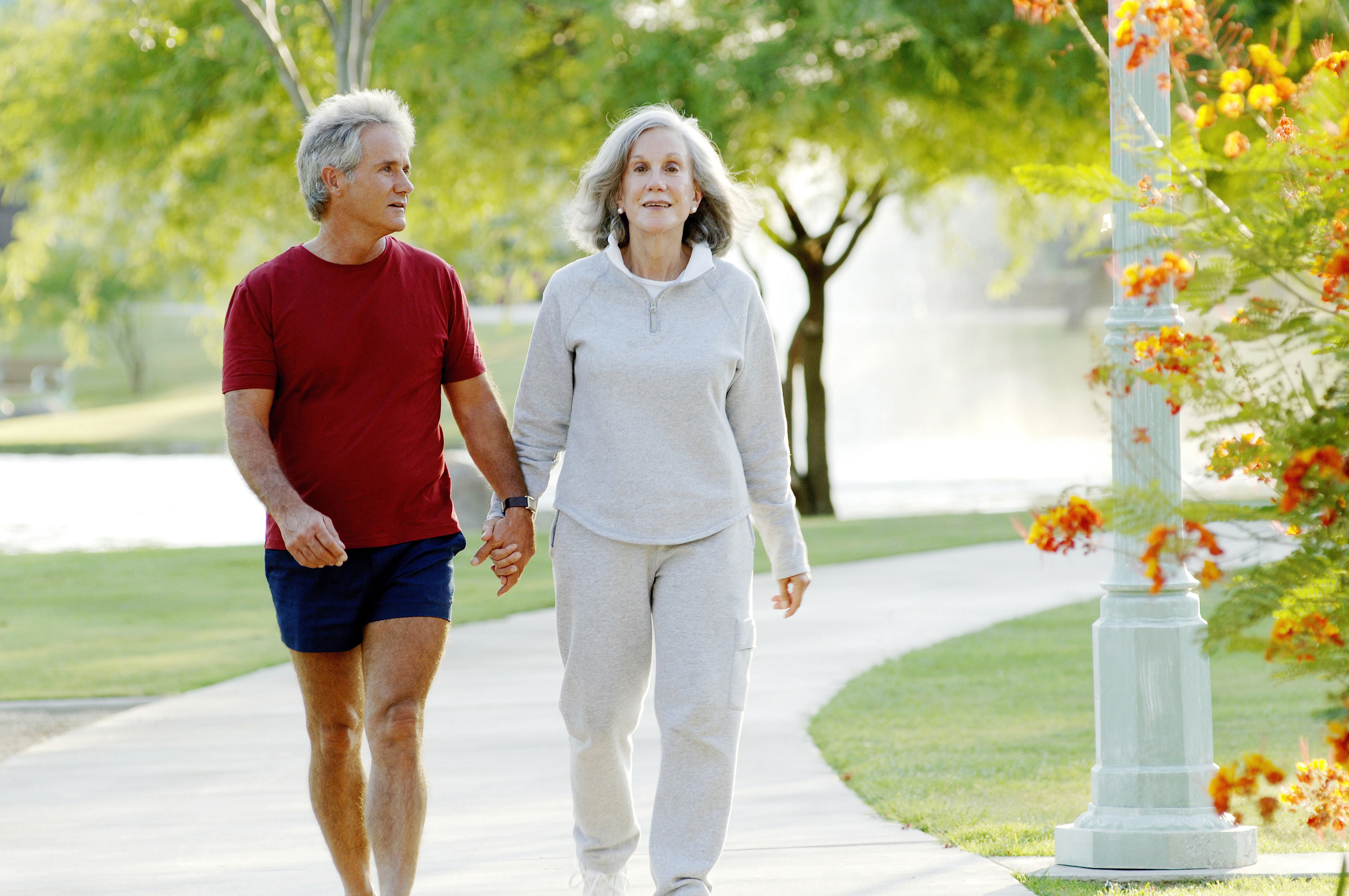 older couple walking because moderate exercise may offer protection from Alzheimer's